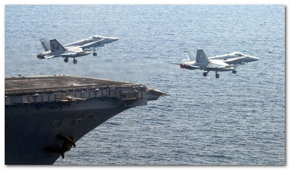 Fighter Jets taking off from an aircraft carrier, via Wikimedia Commons